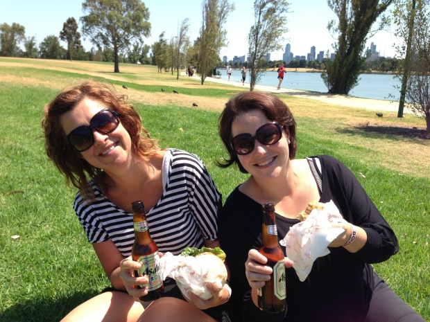 AMY and ALEX on an ANGLE in ALBERT PARK eating AMERICAN BURGERS with ASAHI beer. Clever hey?!