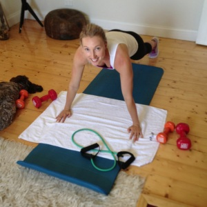 Genevieve ever so capably demonstrating my new program. Wilson to the left, practising the plank is his own little way.
